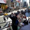 A man takes a photo in New York\'s Times Square, Thursday, April 25, 2013. The Boston Marathon bombing suspects had planned to blow up their remaining explosives in New York\'s Times Square, officials said Thursday. (AP Photo/Richard Drew)