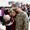 Ashlee Kiser hugs her husband Spc. Jenzen Kizer while holding their son Jack, eight months, at a deployment ceremony for 149th General Support Aviation Battalion (GSAB), as they prepare for deployment to Afghanistan in support of Operation Enduring Freedom on Thursday, April 25, 2013 in Lexington, Okla. Photo by Steve Sisney, The Oklahoman