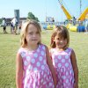 Cassidy Condray and Calynn Condray take time between rides at LibertyFest at the University of Central Oklahoma. BY JOHN A. WILLIAMS, THE OKLAHOMAN