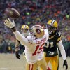 Photo - San Francisco 49ers wide receiver Michael Crabtree (15) misses a pass reception against Green Bay Packers cornerback Davon House (31) during the first half of an NFL wild-card playoff football game, Sunday, Jan. 5, 2014, in Green Bay, Wis. (AP Photo/Mike Roemer)