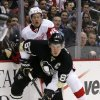 Photo - Pittsburgh Penguins' Sidney Crosby (87) collides with Detroit Red Wings' Danny DeKeyser (65) during the second period of an NHL hockey game in Pittsburgh, Wednesday, April 9, 2014. (AP Photo/Gene J. Puskar)