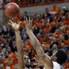 Oklahoma\'s Amath M\'Baye (22) shoots over Oklahoma State\'s Marcus Smart (33) during the Bedlam men\'s college basketball game between the Oklahoma State University Cowboys and the University of Oklahoma Sooners at Gallagher-Iba Arena in Stillwater, Okla., Saturday, Feb. 16, 2013. Photo by Sarah Phipps, The Oklahoman