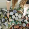 A student helps load food collected for the Regional Food Bank of Oklahoma at Bishop McGuinness High School Friday, November 9, 2012. The school collected 75,660 pounds of food. Photo by Doug Hoke, The Oklahoman