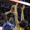 Dallas Mavericks\' O.J. Mayo (32) loses the ball on a shot against Cleveland Cavaliers\' Anderson Varejao, from Brazil, in the first quarter of an NBA basketball game on Saturday, Nov. 17, 2012, in Cleveland. (AP Photo/Mark Duncan)