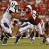 Oklahoma\'s Adrian Taylor (86) puts the pressure on Utah State offensive lineman Tyler Larsen (75) during the second half of the college football game between the University of Oklahoma Sooners (OU) and Utah State University Aggies (USU) at the Gaylord Family-Oklahoma Memorial Stadium on Saturday, Sept. 4, 2010, in Norman, Okla. Photo by Chris Landsberger, The Oklahoman