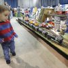 Photo - Three year old Logan Meadows runs to keep up with a model train during the OKC Train Show at State Fair Park in Oklahoma City, OK, Saturday, December 1, 2012,  By Paul Hellstern, The Oklahoman