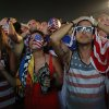 Photo - Fans of the United States national soccer team react, in frustration, as they watch their team's World Cup round of 16 match against Belgium on a live telecast inside the FIFA Fan Fest area on Copacabana beach in Rio de Janeiro, Brazil, Tuesday, July 1, 2014. Belgium beat the United States 2-1 in extra time to reach World Cup quarterfinals. (AP Photo/Leo Correa)