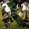 Santa Fe\'s Michael Fiberesima (9) takes down Memorial\'s Warren Wand (6) during a high school football game between Edmond Memorial and Edmond Santa Fe at Wantland Stadium in Edmond, Okla., Friday, Oct. 26, 2012. Photo by Garett Fisbeck, The Oklahoman