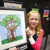 Cross Timbers fifth-grader Halle McMullen poses with her first place-winning tree art at Edmond\'s celebration of Arbor Week at the Edmond Library, March 26, 2012. Photo By David McDaniel/The Oklahoman