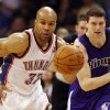 Oklahoma City\'s Derek Fisher (37) leads a fast break after stealing the ball from Sacramento\'s Jimmer Fredette (7) during the NBA basketball game between the Oklahoma City Thunder and the Sacramento Kings at Chesapeake Energy Arena in Oklahoma City, Friday, April 13, 2012. Oklahoma City won, 115-89. Photo by Nate Billings, The Oklahoman