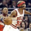Chicago Bulls guard Richard Hamilton, right, looks to a pass as Washington Wizards guard Bradley Beal defends during the first half of an NBA basketball game in Chicago on Saturday, Dec. 29, 2012. (AP Photo/Nam Y. Huh)