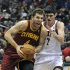 Cleveland Cavaliers\' Luke Walton (4) drives to the basket around Milwaukee Bucks\' Ersan Ilyasova (7) during the first half of an NBA basketball game Saturday, Dec. 22, 2012, in Milwaukee. (AP Photo/Jim Prisching)