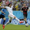 United States\' Jermaine Jones goes with the ball as Germany\'s Per Mertesacker watches, at right, during the group G World Cup soccer match between the USA and Germany at the Arena Pernambuco in Recife, Brazil, Thursday, June 26, 2014. (AP Photo/Matthias Schrader)