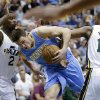 Denver Nuggets\' Danilo Gallinari, center, drives to the basket as Utah Jazz\'s Marvin Williams (2) and teammate Derrick Favors (15) defend in the second quarter during an NBA basketball game on Wednesday, April 3, 2013, in Salt Lake City. (AP Photo/Rick Bowmer)