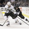 Photo - Dallas Stars' Alex Goligoski, left, is defended by Los Angeles Kings' Anze Kopitar, of Slovenia, during the first period of an NHL hockey game in Los Angeles, Sunday, April 21, 2013. (AP Photo/Jae C. Hong)