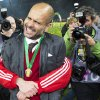 Photo - Bayern's Franck Ribery of France, obscured, hugs Bayern head coach Pep Guardiola of Spain, front, after winning the German Soccer Cup Final between FC Bayern Munich and Borussia Dortmund at the Olympic Stadium in Berlin, Germany, Saturday, May 17, 2014. (AP Photo/Gero Breloer)