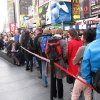A line of ticket-buyers wait at the TKTS booth, which sells discount tickets to Broadway shows, in New York\'s Times Square on Wednesday, Oct. 31, 2012. Most Broadway theaters were reopening Wednesday for regular matinee and evening performances following several days of closures related to superstorm Sandy. (AP Photo/Beth J. Harpaz)