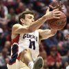 Photo - Gonzaga guard David Stockton pulls in a loose ball during the second half in a second-round game against Oklahoma State in the NCAA men's college basketball tournament Friday, March 21, 2014, in San Diego. (AP Photo/Denis Poroy)