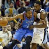 Oklahoma City\'s Kevin Durant (35) works against Memphis\' Tony Allen (9) during Game 3 in the second round of the NBA basketball playoffs between the Oklahoma City Thunder and Memphis Grizzles at the FedExForum in Memphis, Tenn., Saturday, May 11, 2013. Memphis won, 87-81. Photo by Nate Billings, The Oklahoman