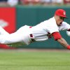 Photo - St. Louis Cardinals second baseman Kolten Wong dives after a single by Atlanta Braves' Freddie Freeman during the first inning of a baseball game Friday, May 16, 2014, at Busch Stadium in St. Louis. (AP Photo/St. Louis Post-Dispatch, Chris Lee) EDWARDSVILLE OUT  ALTON OUT