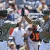 Photo - San Diego Padres' Will Venable, right, is congratulated by Eric Stults after his solo home run against the San Francisco Giants in the second inning of a baseball game in San Diego, Sunday, July 14, 2013. (AP Photo/Lenny Ignelzi)