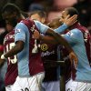 Photo - Aston Villa's Gabby Agbonlahor, right, celebreates his goal with his teammates during their English Premier League soccer match against Sunderland at the Stadium of Light, Sunderland, England, Wednesday, Jan. 1, 2014. (AP Photo/Scott Heppell)
