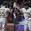 Photo - Pittsburgh Pirates' Pedro Alvarez (24), celebrates with Russell Martin (55) at home plate after hitting a solo home run during the fifth inning of a baseball game against the Chicago Cubs in Chicago, Wednesday, April 9, 2014. (AP Photo/Paul Beaty)