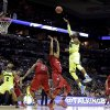 Photo - Baylor's Cory Jefferson (34) shoots over Nebraska's David Rivers (2) during the first half of a second-round game in the NCAA college basketball tournament Friday, March 21, 2014, in San Antonio. (AP Photo/Eric Gay)