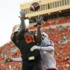 Oklahoma State\'s Justin Blackmon hauls in the first of his two fade route touchdowns against Arizona on Thursday. PHOTO BY NATE BILLINGS, The Oklahoman