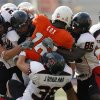 Oklahoma State\'s Perrish Cox (16) is stuffed by the Texas Tech defense during the second half of the college football game between the Oklahoma State University Cowboys (OSU) and the Texas Tech University Red Raiders (TTU) at Boone Pickens Stadium in Stilllwater, Okla., on Saturday, Sept. 22, 2007. OSU won, 49-45. By NATE BILLINGS, The Oklahoman