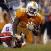 Photo -   Tennessee running back Rajion Neal (20) dives for yardage as he's tackled by Florida Gators defensive back Josh Evans (9) in the second quarter of an NCAA college football game on Saturday, Sept. 15, 2012, in Knoxville, Tenn. (AP Photo/Wade Payne)