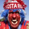 Photo - A supporter celebrates Costa Rica's classification at the end of the World Cup group D match against England, at the Mineirao Stadium, in Belo Horizonte, Brazil, Tuesday, June 24, 2014. Costa Rica finished first in what many considered the World Cup's toughest group after a dour 0-0 draw against England. (AP Photo/Bruno Magalhaes)