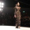 Photo -   A model wears a creation from Marios Schwab, during London Fashion Week, Sunday, Sept. 16, 2012. (AP Photo/PA, Lewis Whyld) UNITED KINGDOM OUT