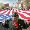Capt. Jamal Wright, of the Northwest Classen High School JROTC, carries the American flag and shouts the cadence to other cadets during the St. Patrick\'s Day Parade in downtown Oklahoma City on Saturday, March 14, 2008. By John Clanton, The Oklahoman