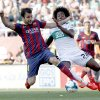 Barcelona\'s Cesc Fabregas, left, duels the ball with Carlos Alberto Sanchez Moreno during a Spanish La Liga soccer match at the Martinez Valero stadium in Elche, Spain, on Sunday, May 11, 2014. (AP Photo/Alberto Saiz)