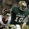 Baylor quarterback Robert Griffin III (10) is chased out of the pocket by Oklahoma linebacker Corey Nelson (7) in the first half of an NCAA college football game on Saturday, Nov. 19, 2011, in Waco, Texas. (AP Photo/Tony Gutierrez)