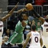 Photo - Boston Celtics' Rajon Rondo, center, looks to pass the ball against the defense of Atlanta Hawks' Paul Millsap, from left, Jeff Teague and DeMarre Carroll, in the first quarter of an NBA basketball game, Wednesday, April 9, 2014, in Atlanta. (AP Photo/David Goldman)