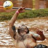 Josh Berglan falls into the mud as he tries to save the ball during the MUDD (Mankind United to Destroy Dystrophy) Volleyball Tournament to benefit the Muscular Dystrophy Association, in Mustang, Okla., Saturday, July 19, 2014. Photo by Nate Billings, The Oklahoman