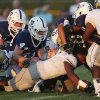 Heritage Hall\'s AJ Knowles (15) loses his helmet as he goes down during a game at Casady High School in The Village, Okla., Thursday, Aug. 30, 2012. Photo by Garett Fisbeck, The Oklahoman