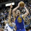 Golden State Warriors\' David Lee, right, shoots over Minnesota Timberwolves\' Derrick Williams in the second half of an NBA basketball game Sunday, Feb. 24, 2013, in Minneapolis. Golden State won 100-99. Lee scored 22 points for Golden State while Williams scored 23 to lead the Timberwolves and had 12 rebounds. (AP Photo/Jim Mone)