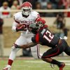 Oklahoma\'s Damien Williams (26) tries to get past Texas Tech\'s D.J. Johnson (12) during a college football game between the University of Oklahoma (OU) and Texas Tech University at Jones AT&T Stadium in Lubbock, Texas, Saturday, Oct. 6, 2012. OU won, 41-20. Photo by Nate Billings, The Oklahoman