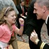 U.S. Navy Lt. Kris Jarboe, of Moore does the twist with his daughter Brianna, 8, during the Norman Parks and Recreation Department\'s 8th annual Daddy Daughter Dance in Norman on Sunday, Feb. 10, 2008. By John Clanton, The Oklahoman