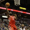 Photo - Houston Rockets guard James Harden (13) goes up for a shot in front of Minnesota Timberwolves forward Luc Richard Mbah a Moute (12) during the second quarter of an NBA basketball game in Minneapolis, Friday, April 11, 2014. (AP Photo/Ann Heisenfelt)