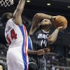 Photo -   Orlando Magic point guard Jameer Nelson (14) goes to the basket against Detroit Pistons forward Jason Maxiell (54) in the first half of an NBA basketball game Friday, Nov. 16, 2012, in Auburn Hills, Mich. (AP Photo/Duane Burleson)
