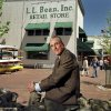 Photo - FILE - In this May 1999 file photo, Leon A. Gorman poses for a photo outside one of the L.L. Bean stores in Freeport, Maine.  The company informed it's workers Monday, May 20, 2013, that Gorman, grandson of the company's founder, L.L. Bean, is retiring as chairman after more than a half-century as chairman or CEO of the retailer. (AP Photo/Robert F. Bukaty, File)