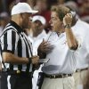 Photo - Alabama coach Nick Saban discusses a call with an official during the first half of an NCAA college football game against Mississippi in Tuscaloosa, Ala., Saturday, Sept. 28, 2013. (AP Photo/Dave Martin)
