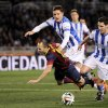 FC Barcelona\'s Andres Iniesta, left, is tackled by Real Sociedad\'s Mikel Gonzalez, right, and falls inside of penal area, during their Spanish Copa del Rey semifinal second leg soccer match against Real Sociedad, at Anoeta stadium, in San Sebastian northern Spain, Wednesday, Feb. 12, 2014. (AP Photo/Alvaro Barrientos)