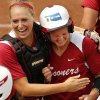 Jessica Shults, left, hugs Shelby Pendley after one of Pendley\'s home runs in the NCAA Super Regional softball game as the University of Oklahoma (OU) Sooners defeat Texas A&M 8-0 at Marita Hines Field on Saturday, May 25, 2013 in Norman, Okla. to advance to the College World Series. Photo by Steve Sisney, The Oklahoman