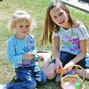 Lilly, 3, and Olivia Cardon, 11, sort Easter eggs Saturday at Touchmark at Coffee Creek\'s celebration of Easter. The retirement community opened its doors to residents in the nearby Coffee Creek neighborhood and joined their homeowners\' association in co-