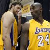 Photo - Los Angeles Lakers forward Pau Gasol, left, of Spain, stands with guard Kobe Bryant, right, during the NBA basketball team's media day Saturday, Sept. 28, 2013, in El Segundo, Calif. (AP Photo/Alex Gallardo)